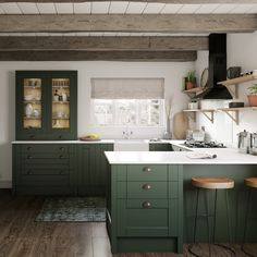 dark green kitchen You asked and we delivered, please meet our NEW Fairford Dark Green This on-trend colour, and classic Shaker door, creates a balance between modern and traditiona Dark Green Kitchen, Green Kitchen Cabinets, Kitchen Island, Shaker Style Kitchens, Home Kitchens, Howdens Kitchens, Ikea Bodbyn Kitchen, Armoire, White Tile Backsplash