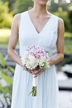 North Raleigh Florist wedding bridesmaid bouquet with pastel blue and pinks with some subtle white accents. we love it <3