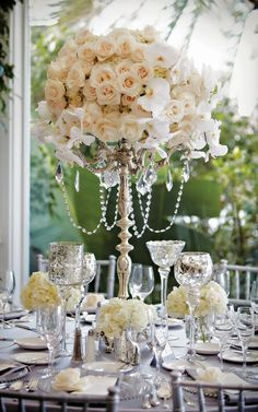 Crystals hanging from the candelabras  love the idea, instead of gems pearls though and instead of a perfect round circle more of an abstract shape  #weddings #flowers #weddingflowers #floralarrangements #weddingfloralarrangements #jevelweddingplanning #jevel