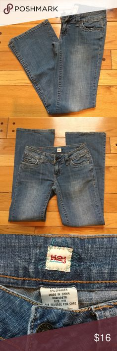 """H2j Production Boot Cut Jeans Good, used condition with a lot of life left! Soft, worn in medium wash denim low rise jeans with zipper fly, button closure and 5 pocket styling. Very mild distressing noted on pocket rims. Back pockets are embellished. 97% cotton, 3% spandex...good amount of stretch. When flat, waist measures approx. 15"""" across, front rise approx. 7"""" and inseam approx. 31"""" H2j Production Jeans Boot Cut"""