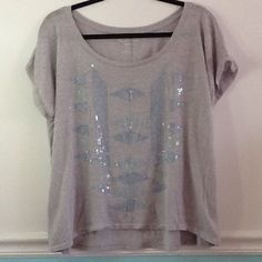 AE high-low sequined swing t shirt American Eagle hi-low swing tshirt. Super relaxed fit in a heat here'd gray with blue stitching and clear sequins. In great condition American Eagle Outfitters Tops