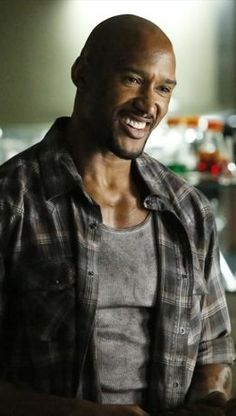 "Agent Alphonso 'Mac' Mackenzie played by Henry Simmons. Introduced in season two of ABC's ""Agents of S.H.I.E.L.D."""