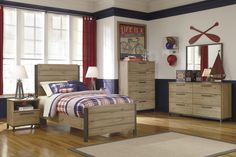 Nate Twin Bedroom Group. This contemporary youth bedroom collection pairs replicated elm grain with metal accents for modern rustic style. Available at Rotmans Worcester, MA