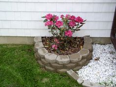 How to Build a Raised Bed with Retaining Wall Bricks - Backyard Gardening.