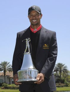 Woods of the U.S. holds the trophy after he won the Arnold Palmer Invitational PGA golf tournament in Orlando