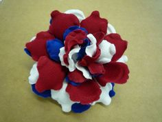 Go Team USA! Proud to still be making flowers right here in America.    Red White and Blue Fabric Flower Pin