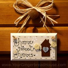A Wooden Home Sign
