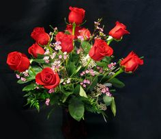 Simple and elegant red roses. Call 608-221-8800 and order flowers today!