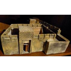 Sawdust fired ceramic sculpture of an adobe Kuwaiti house displaying the entrance to the diwaniyah courtyard. In private collection.
