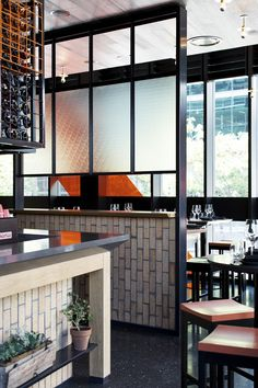 || Bar Nacional — Melbourne . Black framed screen with frosted glass and vertical brick low height wall