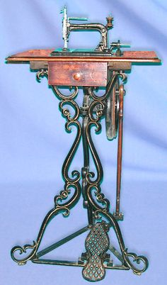 This pretty tripod treadle was marketed by E.Pruckner of Berlin, Germany during the latter half of the 19th century. The machine head is a lockstitch design of near - miniature proportions.