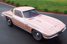 """1964 Corvette - This Pink Pearl '64 Sting Ray was a special Chevrolet Styling/Engineering project by then-Chevy boss Semon """"Bunkie"""" Knudsen for his wife, Florence. Along with the non-standard Pink Pearl paint, other cues that this midyear differs from other '64s are the domed hood, '65-style fender louvers and rocker panel trim, and the """"396"""" fender badges. The pink color scheme extends to the """"pinkwall"""" tires. Behind the three-prong knockoffs are prototype four-wheel disc brakes."""
