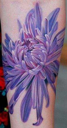 Chrysanthemum flower tattoo by Phil Garcia.