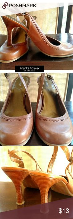 Nine West leather upper Brown leather upper with rubber bottoms.  One heel has some scratches with normal wear. Good used condition. Nine West Shoes Heels