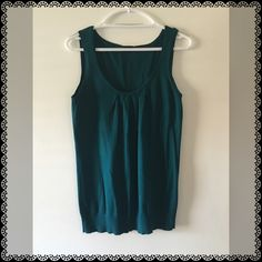 """Hunter Green Sleeveless Rouched Knit Top Condition: great Size tag:  large Measurements:     •. Chest 34""""    •.  Length 27"""" Fabric:  100% Pima Cotton  Care: machine wash cold, line dry.  • Next day delivery to USPS. • Many versatile items available, feel free to check out my closet! Ann Taylor Tops"""