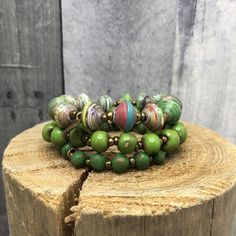 St. Patrick's Set Celebrating Irish festivities all the way from Haiti!   This set is made up of a green cereal box bead bracelet and two different tones of ceramic bracelets- one glazed and the other painted and distressed.