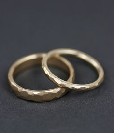 His/hers, hers/hers, his/his faceted wedding band set  Simply stunning for men or women, these minimalist and modern rings incorporate timeless design with just a little edge. The beauty of this ring is its unusual finish. Every facet is created my hand, making each ring unique to you. The juxtaposition of the planes and edges creates depth and contrast, a little different each time depending on the light. The result is special yet understated. I designed these rings to be worn...