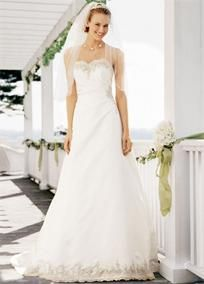 Show everyone how dreams do come true as you walk down the aisle with elegance and grace in this timeless satin wedding gown!   Features lovely beaded lace detailing along the sweetheart neckline and at the hem.  Classic a-line silhouette is romantic and traditional.  Chapel Train. Available in Ivory Champagne.