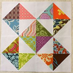 I'm thinking this is definitely the one for my One Scrappy Bee quilt! I know it's not very complicated or challenging but I love how the simple design lets all the colors and patterns shine. The block is from this pattern without the squaring up of squares to 4 1/2