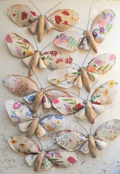 These are made of fabric, but they could be adapted for kids, by making wings of wall paper scraps, and the bodies of paper mache or old-fashioned clothes pins.
