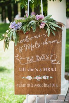 Featured on Ruffled! Bridal Shower Welcome on stained wood. http://ruffledblog.com/jefferson-street-mansion-bridal-shower/