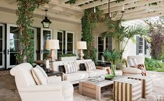 This patio is simple, yet beautiful. The greenery, white accents and stone all tie in well with one another!