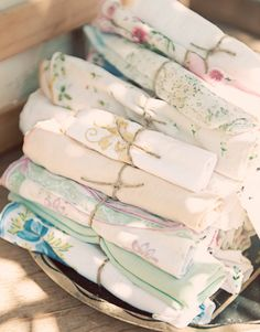Pretty idea for a bridal shower.  Collect old napkins and handkerchiefs from estate sales and thrift stores.