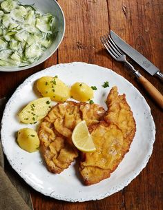Viennese Schnitzel with potatoes and cucumber salad