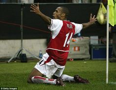 Thierry Henry celebrates his magnificent goal as Arsenal ran riot at the San Siro to progr...