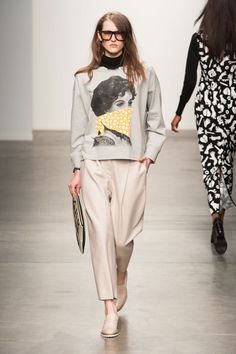 Grey sweatshirt with a large print and nude loose fitted slacks, neutral platform shoes with white soles, Karen Walker, Fall 2014