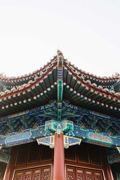 Jingshan Park Beijing China - Climb this artificial hill for an amazing view of Beijing and the Forbidden City. The pavilions give you a close-up at Chinese architecture // http://localadventurer.com