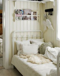 Bead board, shelves, and book racks.  Look at the angel wings hanging by the bed!