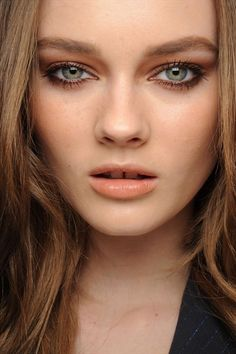 orange bronzle lids to crease, and peachy cheeks