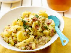 Coat tender boiled potatoes in a vinegar-mustard sauce along with crisp minced bacon and fresh parsley for this classic German-Style Potato Salad that's perfect for picnics with friends and family.