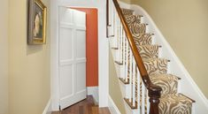 Trim out a slab door with poplar boards to create a hidden passage disguised as a paneled accent wall