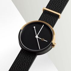 The gold black dual tone plating on the Eclipse by Australian brand AÃRK is inspired by night and day and the moon's movement in relation to the Earth and the sun. Get yours at www.dezeenwatchstore.co
