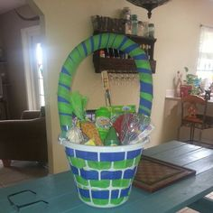 Laundry basket Easter Basket I used a pool noodle for the handle and just weaved crepe paper through the basket and around the handle.