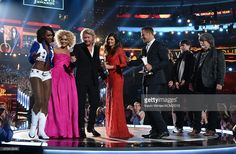 Recording artists Kimberly Schlapman, Phillip Sweet, Karen Fairchild and Jimi Westbrook of music group Little Big Town accept the Vocal Group of the Year award from a Dallas Cowboys Cheerleader, and recording artists Teddy Gentry and Randy Owen of music group Alabama onstage during the 50th Academy Of Country Music Awards at AT&T Stadium on April 19, 2015 in Arlington, Texas.