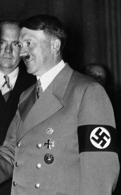 September, 1938 in Ba Godesberg. Paul Schmidt with Hitler shaking Chamberlain's hand. (via putschgirl)