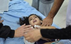 A wounded Palestinian girl lies on a hospital bed after an Israeli air strike in the northern Gaza Strip, on November 17, 2012. (Reuters/ Ali Hassan)