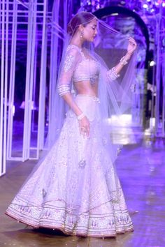 Lisa Haydon in a light lilac lengha / Tarun Tahiliani at Aamby Valley Bridal Delhi 2013