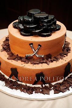 Groom's Hockey Cake Love the pucks on top!...forget the groom. This is going to be mine.