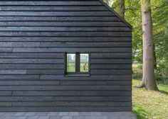Barend Koolhaas completes a blackened timber house with a triangular floor plan.