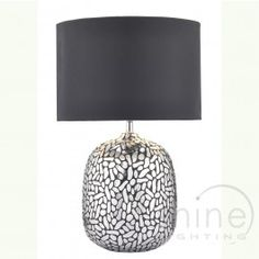 Cazanove CAZ4232/X 1 Light Table Lamp, Dar Lighting. Contemporary table lamp with silver pellet decorative finish resin base. Complete with black satin drum shade with silver lining. Operated by an in line rocker switch. Double Insulated (Class II) 1 x 60w E27 (ES) GLS bulbs (Not Included) Height: 52cm Diam: 33cm £89.00