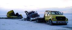 Three Stuck Tow Trucks