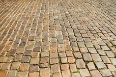 background of the pavement (backgrounds, black, brick, brown, cobblestone, cold, concrete, construction, contemporary, curve, day, diminishing, driveway, floor, gray, in, landscaped, lane, level, life, nobody, old, on, patio, pattern, paver, paving, pedestrian, perspective, point, rectangle, rock, rough, row, sidewalk, stone, suburb, sunlight, textured, tilt, travel, urban, vanishing, walkway)