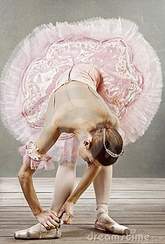 """Young Dancer Fixing Her Slippers,"" by Zojakostina. Photo available as a stock image."