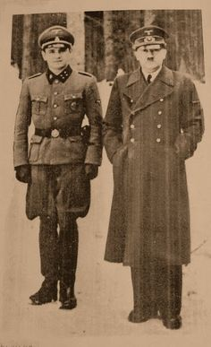 Adolf Hitler with his trusted driver Erich Kempka in an undated photo in Rastenburg. Kempka joined Hitler's personal SS guard in 1932 and was there until the very last day. After the war he wrote his memoirs that sold several editions. In Nuremberg, Kempka was the only one to testify that he saw Martin Bormann getting killed by an exploding shell.