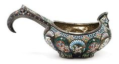 <b>Russian Cloisonne Enameled Silver Kovsch  </b></i> <br  /> Decorated with white, green, blue, maroon, turquoise and pale yellow stylized foliate motifs. <i>Height 3 3/4 inches, width 7 1/2 inches.</b></i>