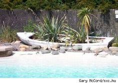 DIY Backyard Landscaping | Pool-side landscape incorporating an old row boat, source: sxc.hu.